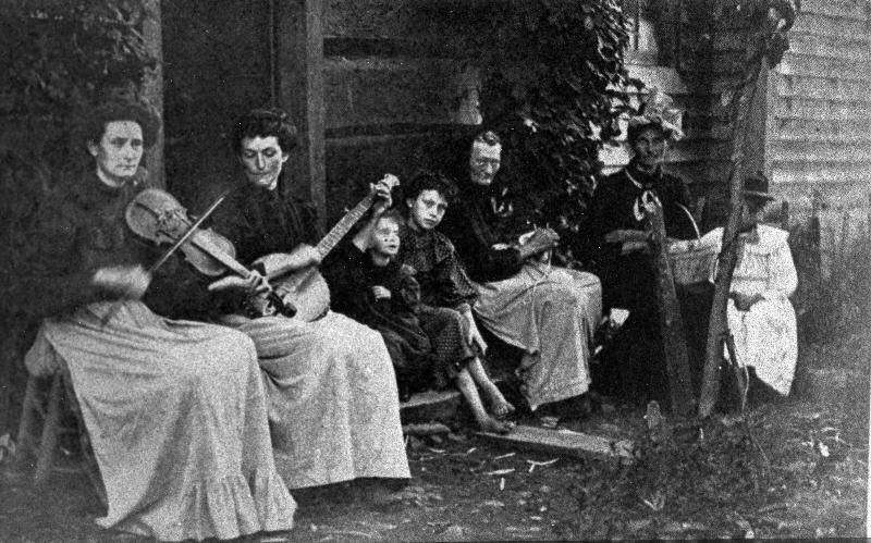 Ol' time Appalachian family with musical instruments